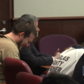Two people cry in courtroom