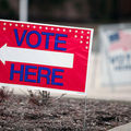 "Red, white and blue ""Vote"" sign"