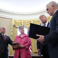 Three White men and White woman stand in Oval Office.