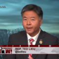 Rep. Ted Lieu looks at the camera, image of the U.S. Capitol in the background