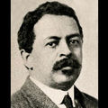 Old photograph of man with moustache against browning background