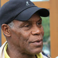Danny Glover in a black cap