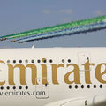 "Plane with ""Emirates"" written on the side"