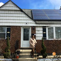 Maureen Grogan, 69, stands outside her solar-powered home in Uniondale, N.Y., on March 4, 2017. She's one of many residents in the town who have decided that to go renewable.