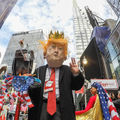 At a large New York City march to protest Trump's 'Muslim ban,' a man dressed up as the president walks.