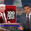 Trevor Noah. Black man shrugs next to graphic of Donald Trump