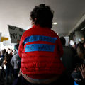 A child wears a slogan on his jacket during a rally against a ban on Muslim immigration at San Francisco International Airport on January 28, 2017, in San Francisco, California.