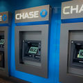 """Activists posted """"No KXL"""" signs to ATMs inside the downtown Chase bank branch on Second Avenue in Seattle on May 8, 2017."""