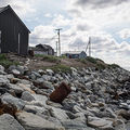 A house sits on the edge of the Chukchi Sea on July 7, 2015, in Shishmaref, Alaska. In April, the Trump administration approved offshore drilling for gas and oil in Arctic regions, including the Chukchi sea.