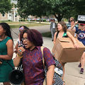 Dozens of residents from Flint, Michigan, march to the officers of Gov. Rick Snyder and Attorney General Bill Schuette to deliver a message in a bottle in Lansing, Michigan, on June 13, 2017.