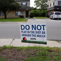 A sign displayed in a front yard request that residents keep fro playing in the dirt or mulch at the West Calumet Housing Complex on September 4, 2016, in East Chicago, Indiana.