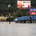 Flood waters rise around a title loan store on Garners Ferry Road October 4, 2015 in Columbia, South Carolina.