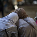 Two women in hijab with their backs to the camera