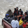 Evacuees ride in the back of a pickup truck after the area was inundated with flooding of Hurricane Harvey on August 30, 2017, in Port Arthur, Texas.