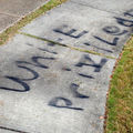 "Sidewalk spraypainted with ""White privilege"""