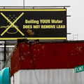 "Billboard reads, ""Boiling your water does not remove lead."""