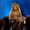 Beyoncé in gold clothing and crown
