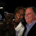 Black woman takes selfie with Doug Jones