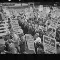 """Black and white photograph of demonstrators attending a rally and hold signs that say things like """"We March for Effective Civil Rights Now."""""""