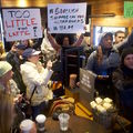 A group of people protest inside of a Starbucks