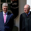 Anthony Kennedy and Neil Gorsuch. Two White men stand outside, one in a dark suit, the other in a black robe.