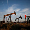 Pump jacks and wells are seen in an oil field on the Monterey Shale formation where gas and oil extraction using hydraulic fracturing, or fracking, is on the verge of a boom on March 23, 2014, near McKittrick, California.