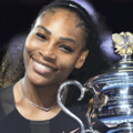 Serena Williams smiles while wearing black outfit and holding silver trophy