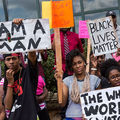 """Black people protest outside. Signs include """"I am a man,"""" """"Blcack lives matter"""" and """"The world is watching."""""""