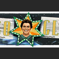 Mary G. Ross on a Google Doodle. Brown woman in a green dress, white pearls, with her face surrounded by a yellow and orange star with green trim. A gray satellite, starry space and Earth are behind her