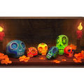 Illustration of ofrenda with red candles, orange leaves and blue and green and red and gold and orange skulls on brown wood platform