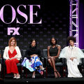 "Janet Mock, Mj Rodriguez, Dominique Jackson, Indya Moore, Billy Porter. Group of Black actors and filmmakers and one White producer on stage with a purple light and purple curtain behind them and a black banner that reads in purple letters ""Pose FX"""