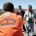 Sergio Medrano, (R) and another volunteer from the Mexican relief organization Agua Para Vida talk with a worker from the government funded migrant relief organization Grupo Beta while out checking watering stations placed in the desert to aid migrants.