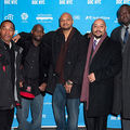 The Exonerated 5: Korey Wise, Antron McCray, Kevin Richardson, Raymond Santana and Yusef Salaam stand in front of a blue and white step and repeat.
