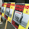 Slavery reparations rally. Black 6-year-old girl stands in front of pro-reparations signs.