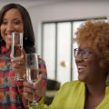 """A Black Lady Sketch Show."" Two Black women raising champagne glasses."