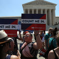 "2020 Census Protest. Outside of the Supreme Court, protestors hold up signs reading, ""Count me in."""