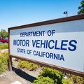 Blue and white sign that reads Department of Motor Vehicles State of California
