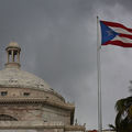 Puerto Rico capitol building in San Juan and Puerto Rican flag