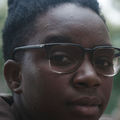 Shante Wolfe-Sisson. Black person looks at the camera.