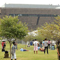 people on the lawn outside of National Museum Of African American History & Culture