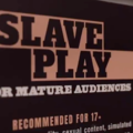 """A brown and peach sign has the words """"Slave Play"""" and a recommendation of 17+"""