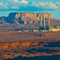The Navajo Generating Station power plant against red rock and blue sky