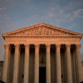 The Supreme Court in D.C. is shown at sunset.