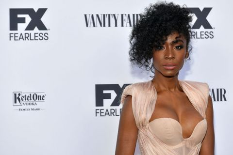 Angelica Ross. Black woman wearing champagne-colored gown in front of FX step and repeat.