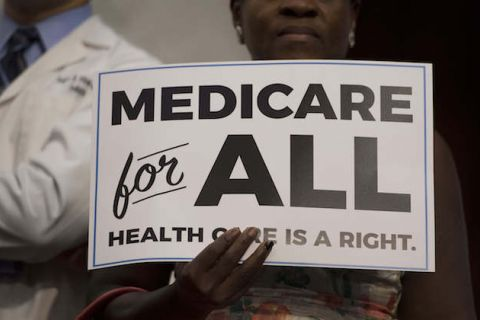 "black and white sign that reads ""Medicare for all"""