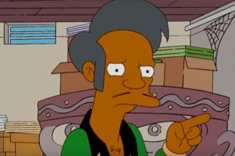 Apu Nahasapeemapetilon. Cartoon of South Asian male with gray hair, thin mustache, wearing green shirt with black collar.