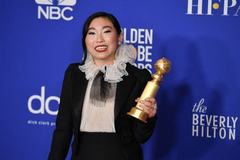 Awkwafina. Asian-American woman with dark hair wearing white and black dress.