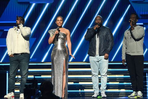 The Grammys. Alicia Keys with Boyz II Men Nathan Morris, Wanya Morris and Shawn Stockman on stage.