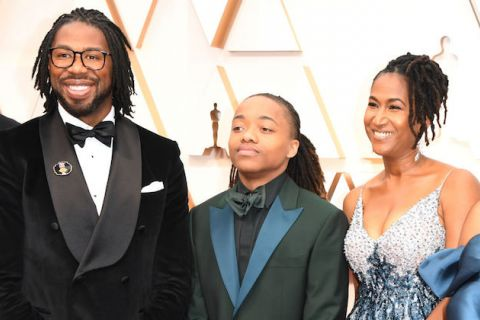 Hair Love. A Black man in a tuxedo with locs, a teen boy with locs in a tuxedo with blue lapels and a Black woman with locs and a silver and blue sequin gown.