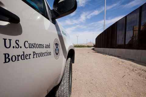Vehicle shown with U.S. Customs and Border Protection written in black on the white door.
